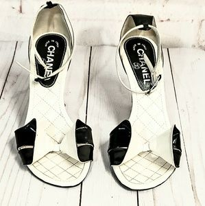 CHANEL Shoes - CHANEL AUTHENTIC BLACK LEATHER BOW HEELS SIZE 38